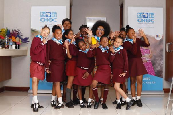 Lillian Dube with Roodepoort Primary School Scholars